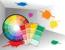 Painter Room with Color Wheel. A color wheel and color swatches are in an empty room with paint splatters on the wall Royalty Free Stock Image