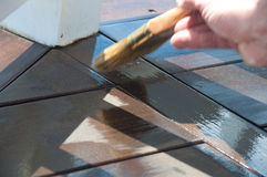 Painter's Brush Staining Deck Royalty Free Stock Photos
