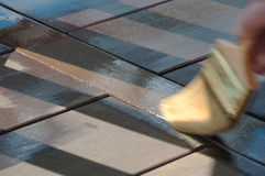 Painter's Brush Staining Deck Stock Photo