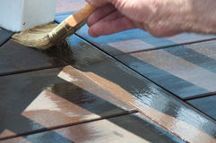 Painter's Brush Staining Deck Stock Images
