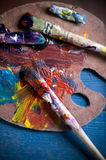 Painter's brushes and old pallet Royalty Free Stock Image