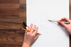 Painter`s hands drawing sketch with pencil. Unrecognizable creative artist making new logo project. Drawing lessons, art school, young artist concept royalty free stock photos