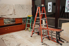 Painter's ladders and tarps. Large room is prepped for painting Stock Images