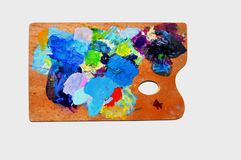 A Painter's Tool. Isolated rectangular palette for oil, tempera and acrylics. Made of  laked wood. This one happens to be mine. Lots of blue and violet and red Royalty Free Stock Photography