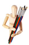 Painter's wooden model with paintbrushes Stock Photo