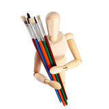 Painter's wooden model with paintbrushes Royalty Free Stock Photos
