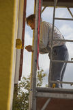 Painter on scaffold Stock Photos