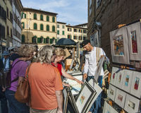 Painter selling art on the street Stock Images