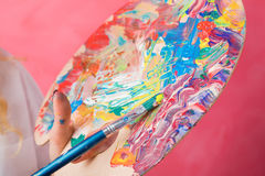 Painter showing colorful paint palette Stock Photography