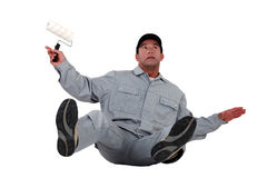 Painter slipping and falling. Craftsman painter slipping and falling Stock Image