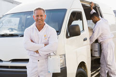 Painter smiling leaning against his van Royalty Free Stock Images