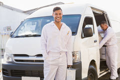 Painter smiling leaning against his van Stock Photography