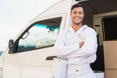 Painter smiling leaning against his van Royalty Free Stock Photos