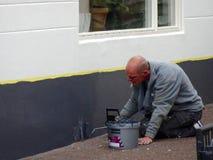 Painter smoking during work Royalty Free Stock Photo