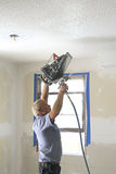 Painter Spraying Texture. Painter painting interior of house that is on the market to be sold Royalty Free Stock Photos
