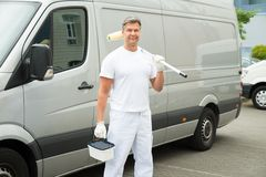 Painter Standing In Front Of Van Royalty Free Stock Photo