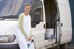 Painter standing with van Stock Photography