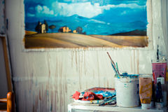 Painter studio with paint and brushes royalty free stock photography