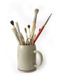 Painter tools. Painter brushes and tools holder on white background stock photo