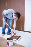 Painter using a paint roller Stock Image