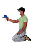 Painter using a spray gun. Stock Photos