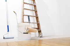 Painter wall concept, ladder, bucket, roll paint on the floor Royalty Free Stock Photos