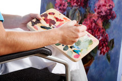 Painter in a wheelchair Royalty Free Stock Image