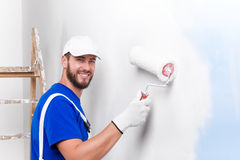 Painter in white dungarees, blue t-shirt Royalty Free Stock Images