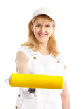 Painter woman. Smiling painter woman in white suit. Isolated over white background Royalty Free Stock Photography