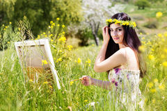 Painter woman is create picture outdoors Royalty Free Stock Photos