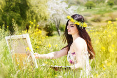 Painter woman is create picture outdoors Royalty Free Stock Image