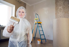 Painter woman. Making her work Stock Photos