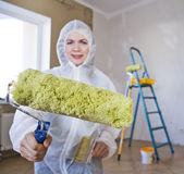 Painter woman. Making her work Royalty Free Stock Photography