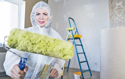 Painter woman. Making her work Royalty Free Stock Photo