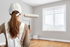 Painter woman with painting roller Royalty Free Stock Photos