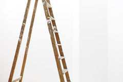 Painter wooden ladder, on white, wall painting Royalty Free Stock Photos