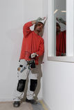 Painter at work. Painter on the job.. Painting the inside of a new factory building with an office Stock Photography