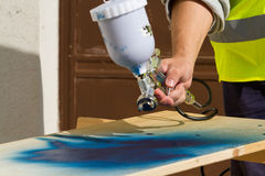 Painter. At work painting a wood Royalty Free Stock Images