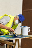 Painter. At work painting a wood Royalty Free Stock Image