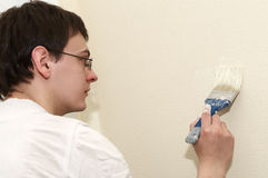 Painter worker decorator with brush Stock Images