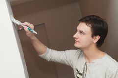 Painter worker decorator with brush Stock Photography