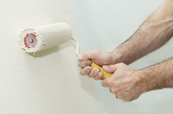 Painter worker hand with roller Royalty Free Stock Image