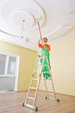 Painter worker during his job. Painter worker during painting job Royalty Free Stock Image