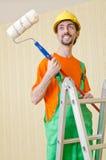 Painter worker during his job Stock Photos
