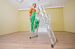 Painter worker during painting Stock Images