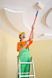 Painter worker during painting. Job Royalty Free Stock Photo