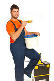 Painter worker on stepladder Royalty Free Stock Images
