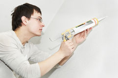 Painter worker using lute royalty free stock image