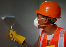 Painter worker wearing  safety work on job Royalty Free Stock Photography