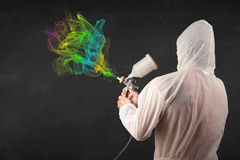 Painter working with airbrush and paints colorful paint Royalty Free Stock Image